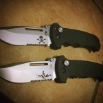 Two custom logos on a couple of 30-000308N Gerber Combat Folders, a skull and cross bones and a bad-girl logo. Great designs on great Gerber knives