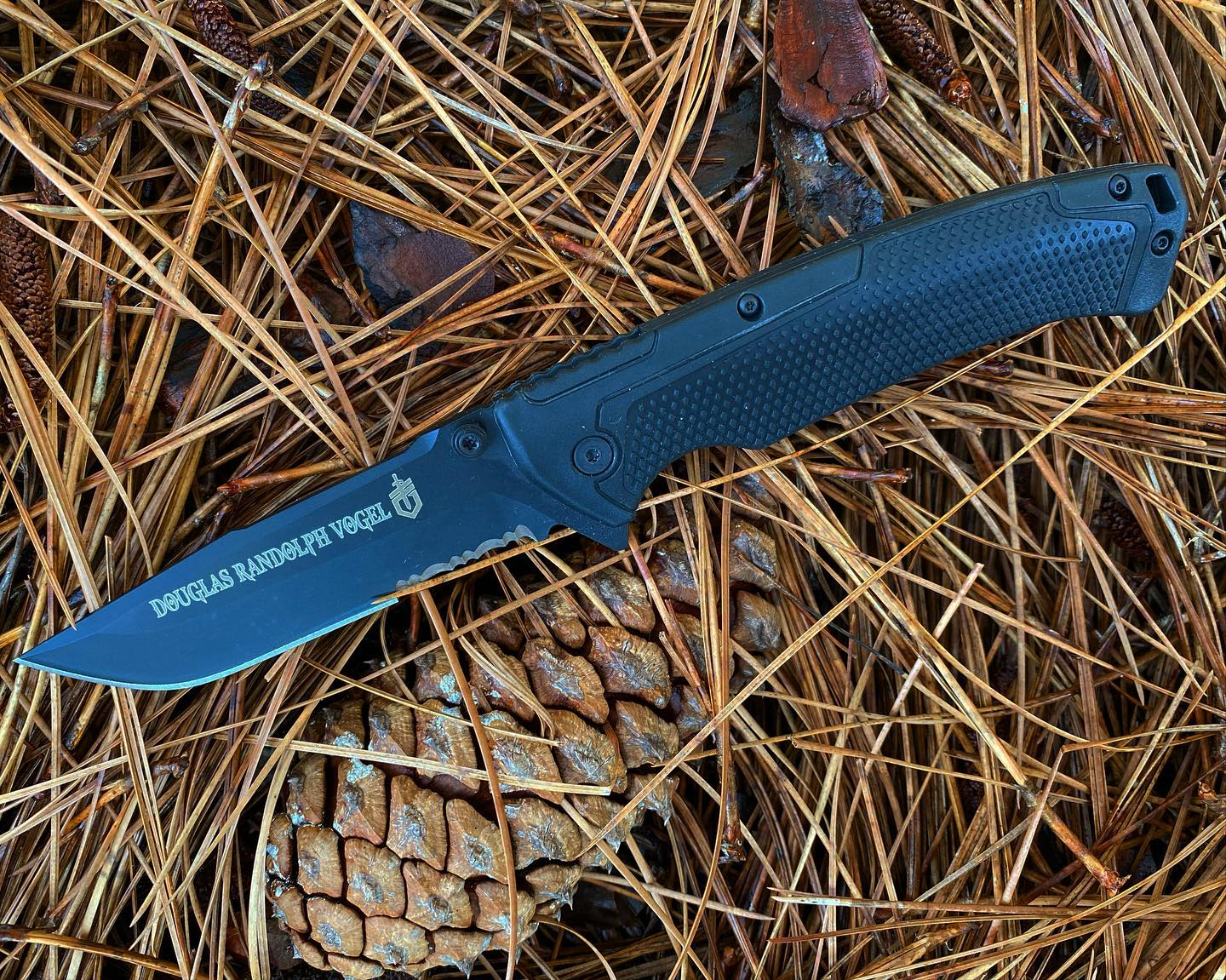 Gerber Decree Tactical half serrated knife 31-002718. Engraved in Gods of War font for a special customer. Has glass breaker on end of handle that is covered with a diamond texture rubber to secure that grip. Get your Decree today! #31-002718 #decree #decreetacticalknife #madeinamerica